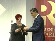 Arman Tatoyan (right) receives PR award